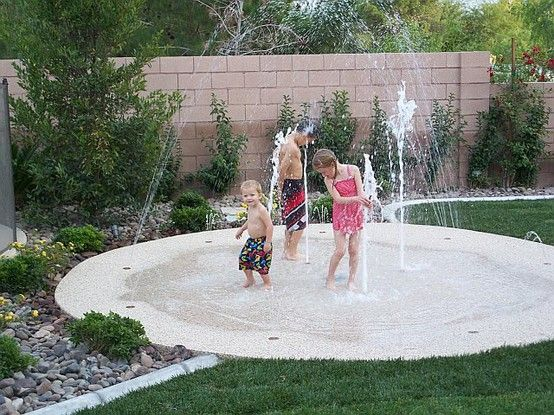 Backyard splash pad! No up keep, small footprint, cheaper than a pool, and safer than a pool. In the winter you can put a fire pit and chairs on it. #backyardlandscaping #outdoorfun