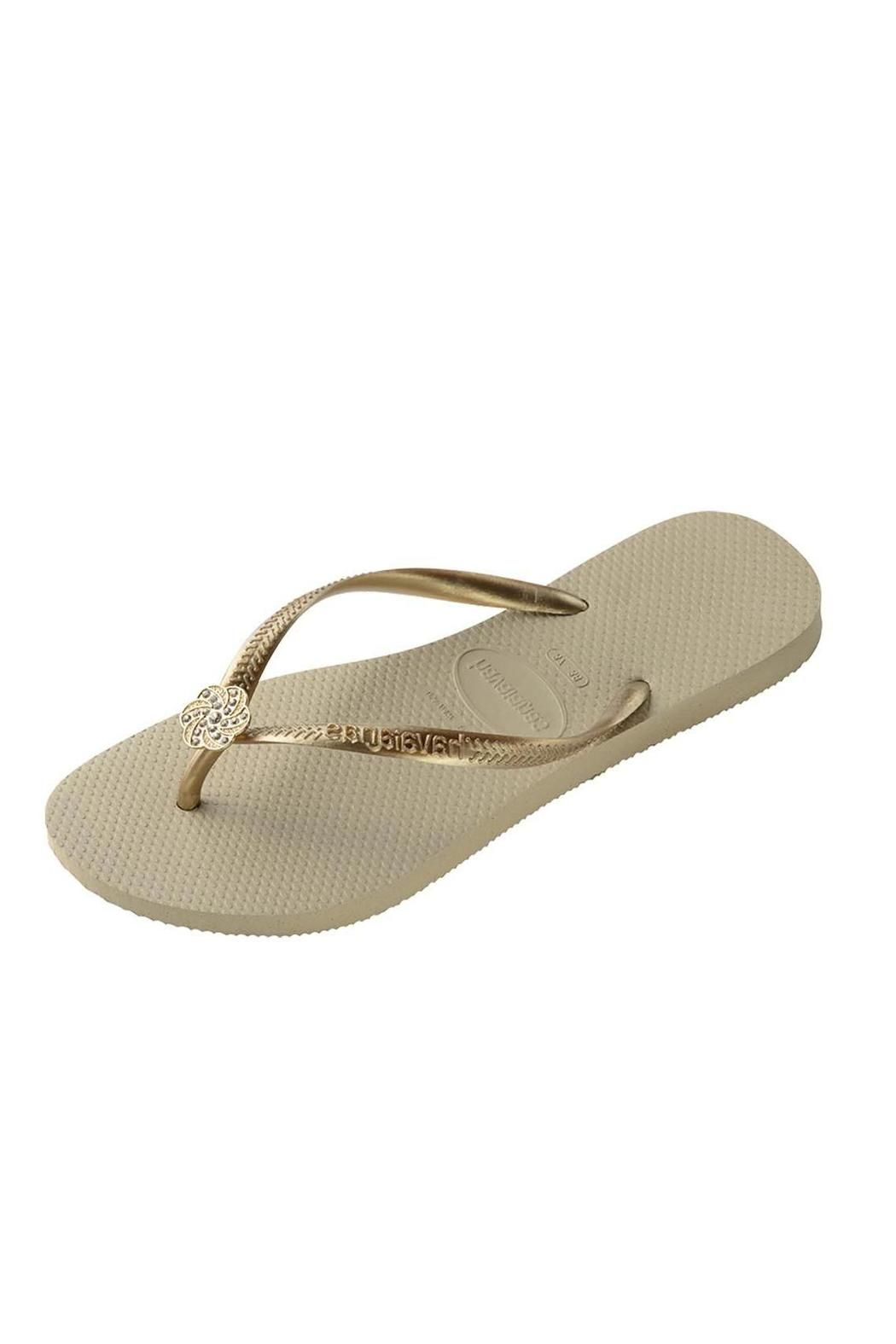 9f6c92df81857b A tonal Havaianas logo and signature textured footbed provide style and  comfort. Cushioned footbed with textured rice pattern and rubber flip flop  ...