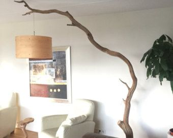 Floor lamp and arc lamp made of weathered old oak branch on black
