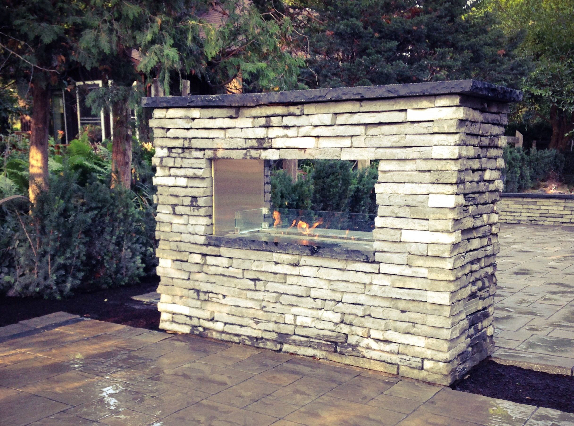 Double Sided Outdoor Fireplace Rivercrest Stone from Unilock Davel