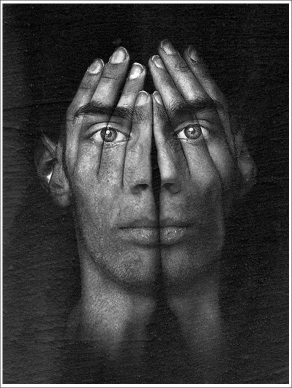 surreal portrait - groom's face w/ bride's hands, emphasis on ring