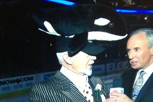 Don Cherry with a whale on his head