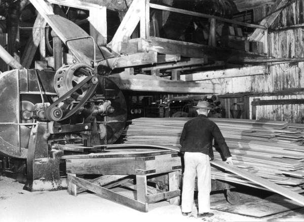 A Worker Operates Re Saw Machine Cutting Siding At Lee