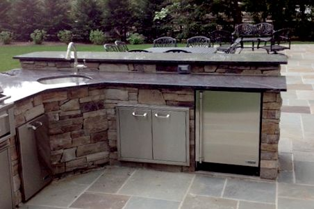 Built in bbq with sink fridge and storage with seating for Outdoor kitchen with sink and fridge
