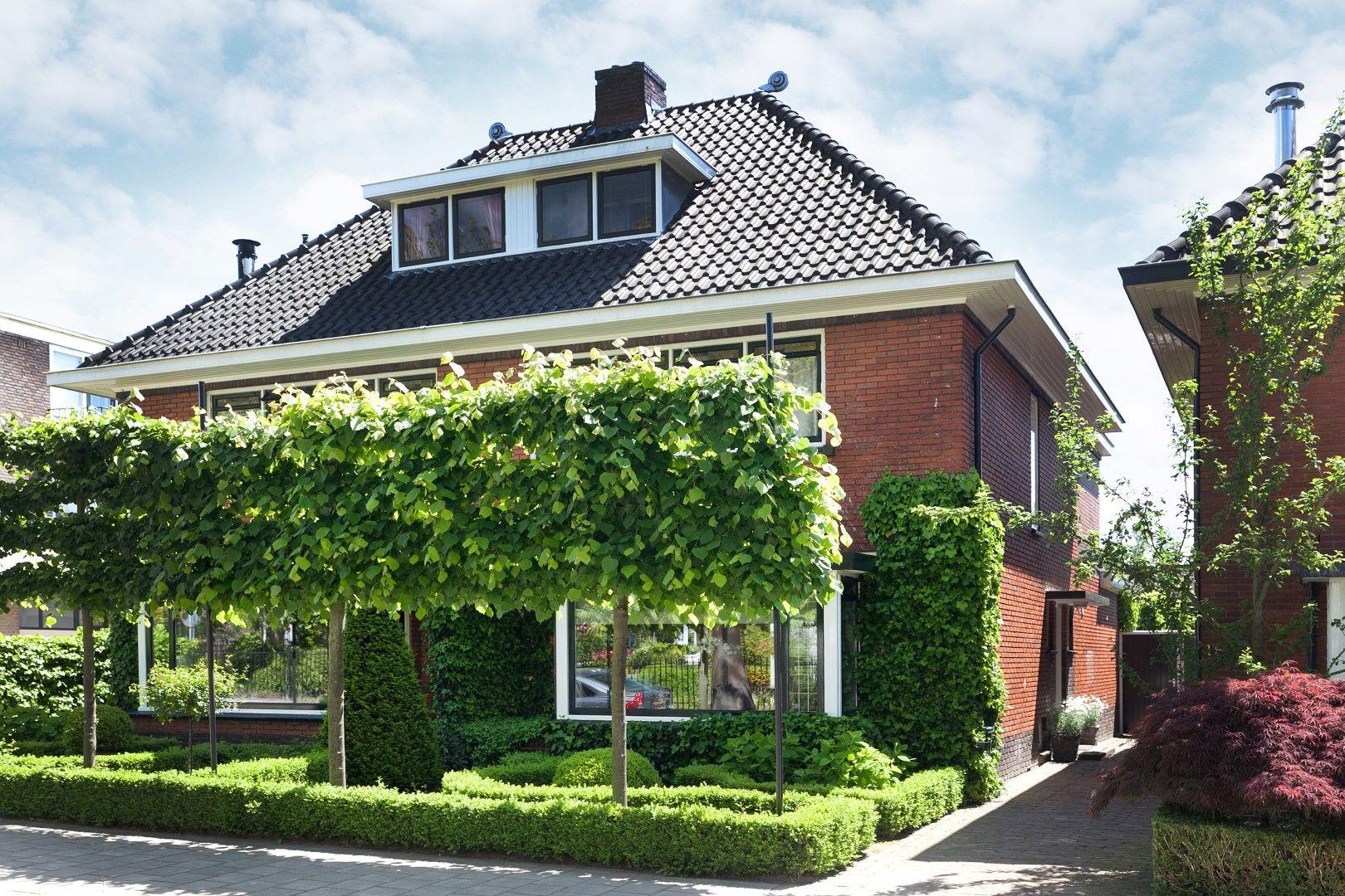 Voortuinen zijn er in talloze vormen en maten maar kennen for Huizen stijlen