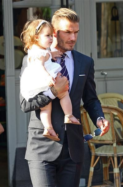 David Beckham takes his daughter, Harper, to a restaurant in London on July 26, 2012.