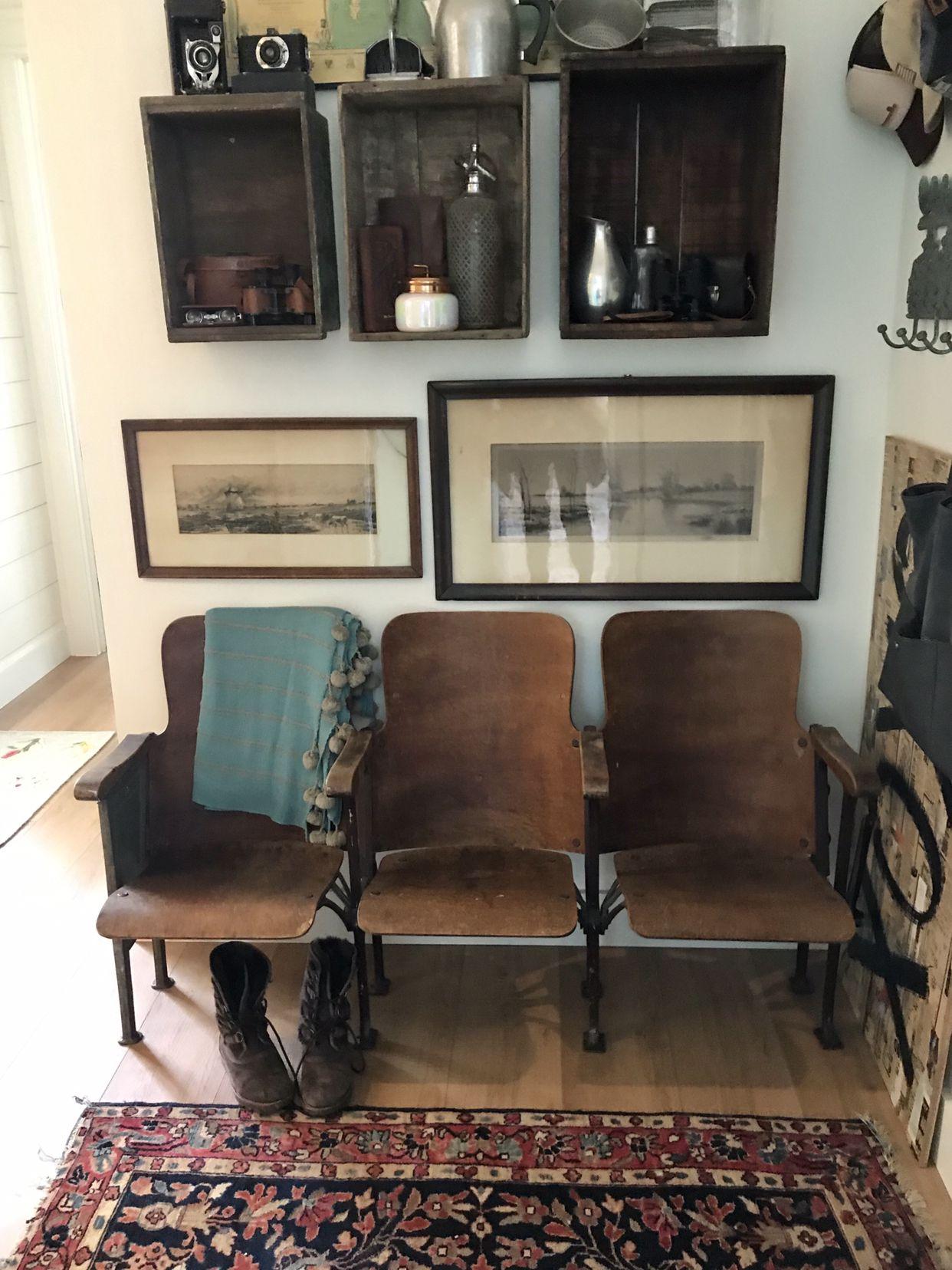Great entryway idea vintage rug and theatre seats