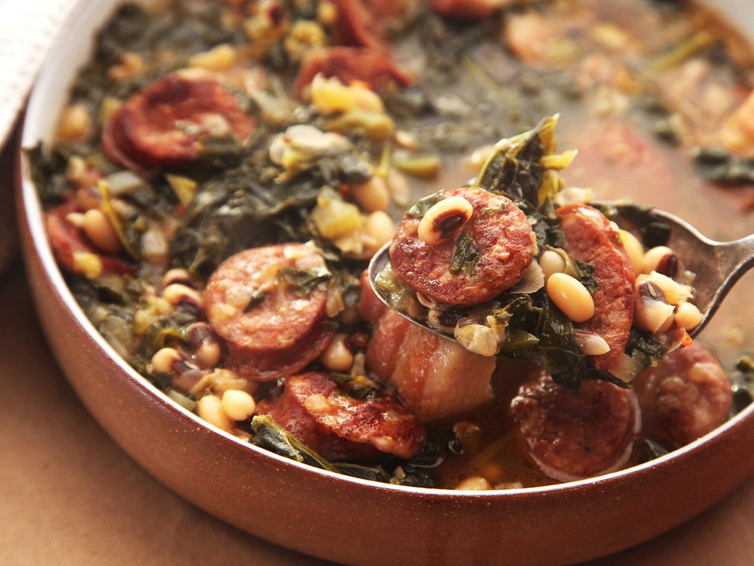Serious Eats: Black Eyed Peas With Kale & Andouille for a Simple One-Pot Dinner