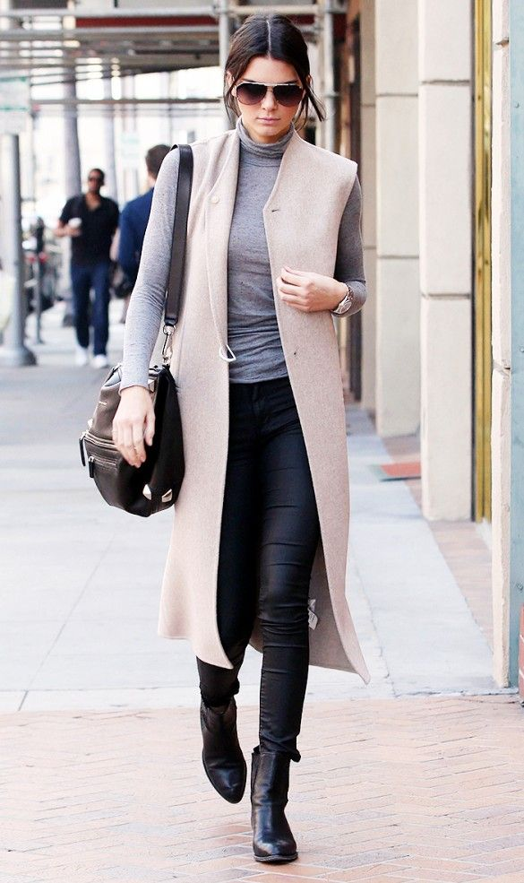 Kendall Jenner wears an Acne Studios vest with Res jeans and Alexander Wang Anouck Cutout-Heel Jodphur Boots.
