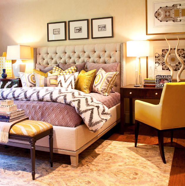 Purple and mustard bedroom with layered patterns.