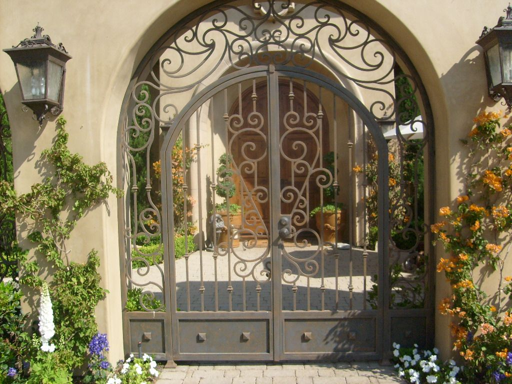 Nice arched wrought iron gate, this will definitely be the entrance ...