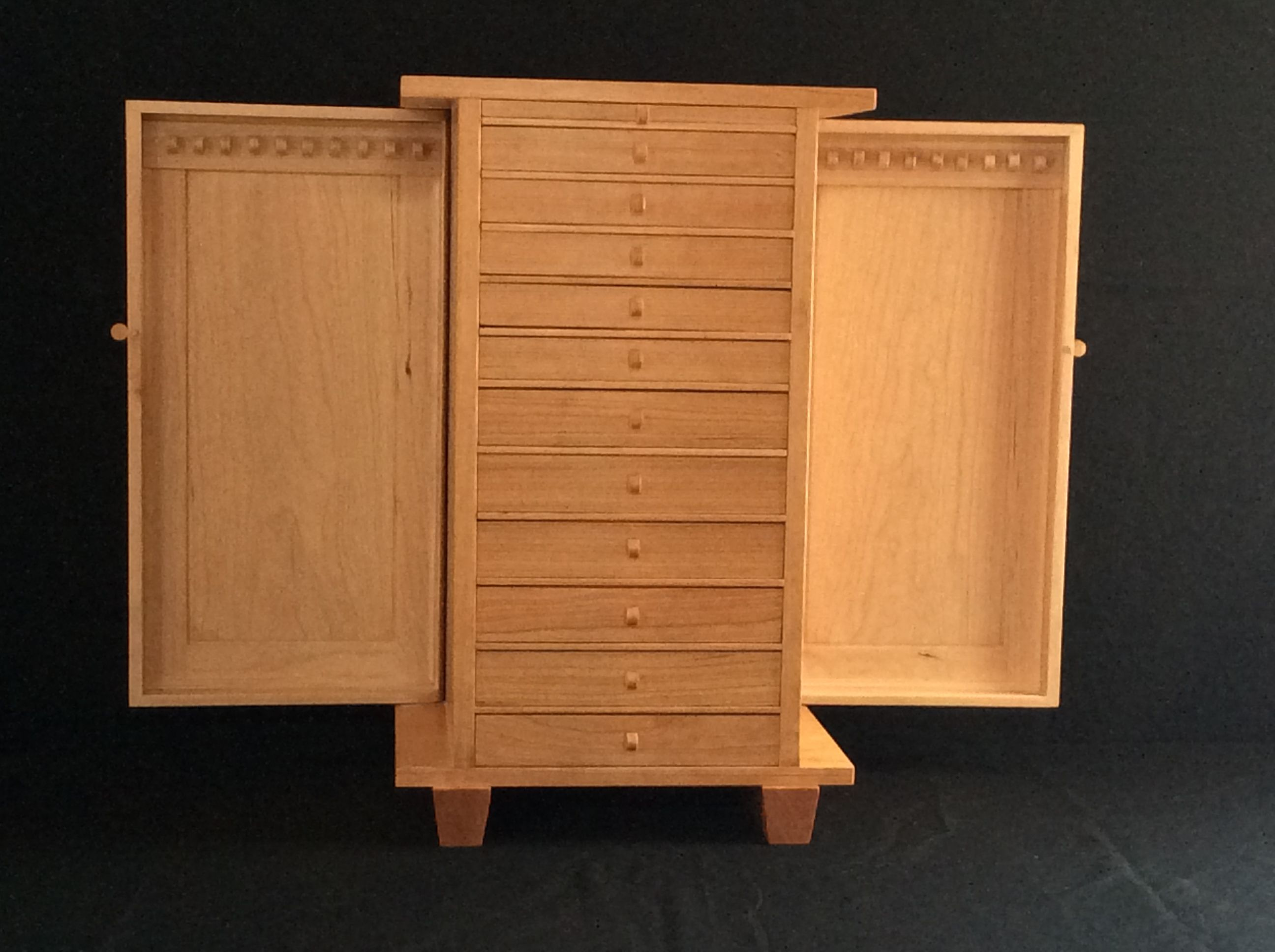 This image shows a jewelry armoire made by David Klenk This image