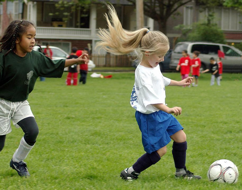litle girls playing soccer...seems so long ago.. Can't