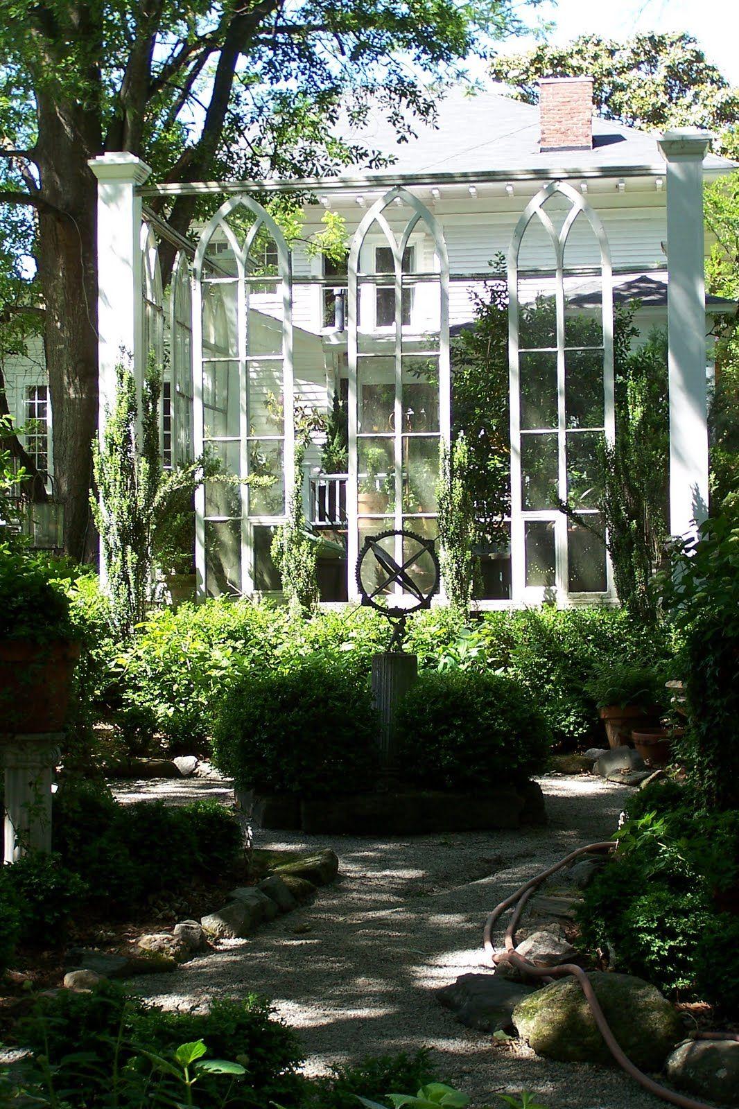 Salvaged church windows create outdoor room