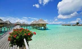 This is a picture of bora bora which is located on an island called Tahiti in french polynesia! This place has white sand and you can see tropical fish just from being above water! On top of all that you can hike along the deck and even see the fish from stepping out your door!