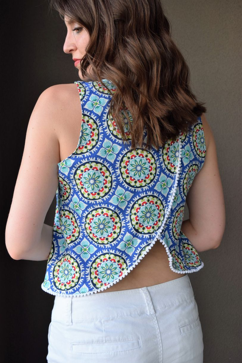Free split back tank top pattern with cute little pom poms!