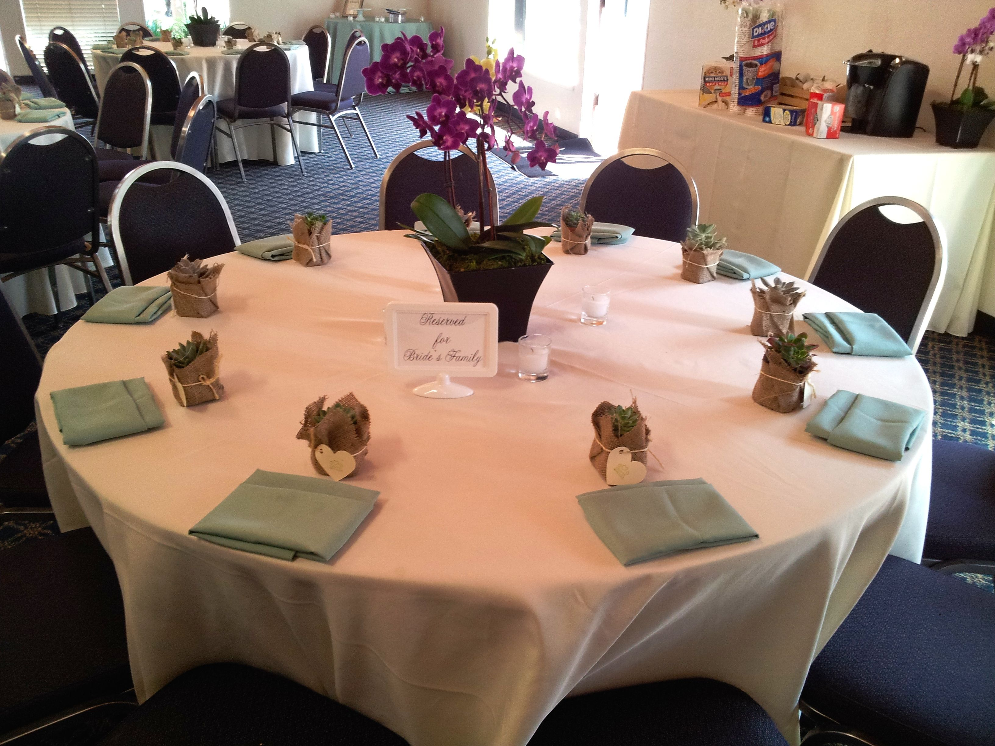 Ivory and sage seating tables for wedding reception at Marina Village