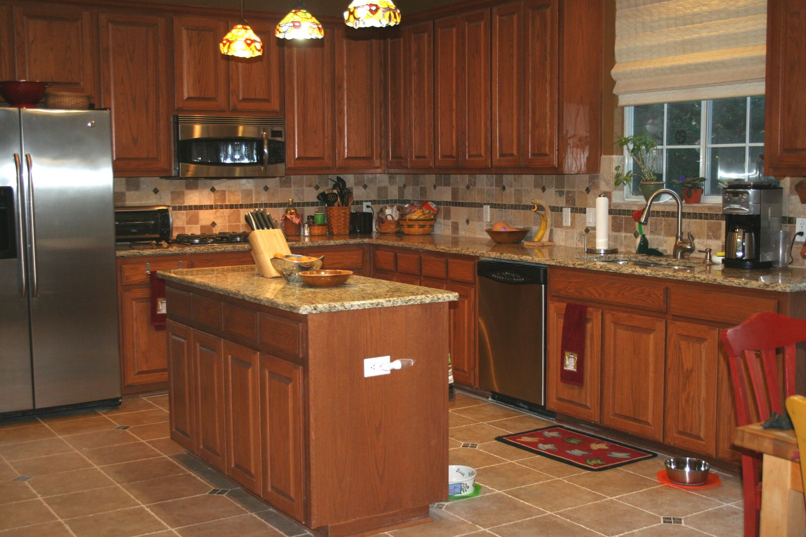 Back Splash Designs For Kitchen With Beige And Brown Granite Counter Tops Oak Cabinets