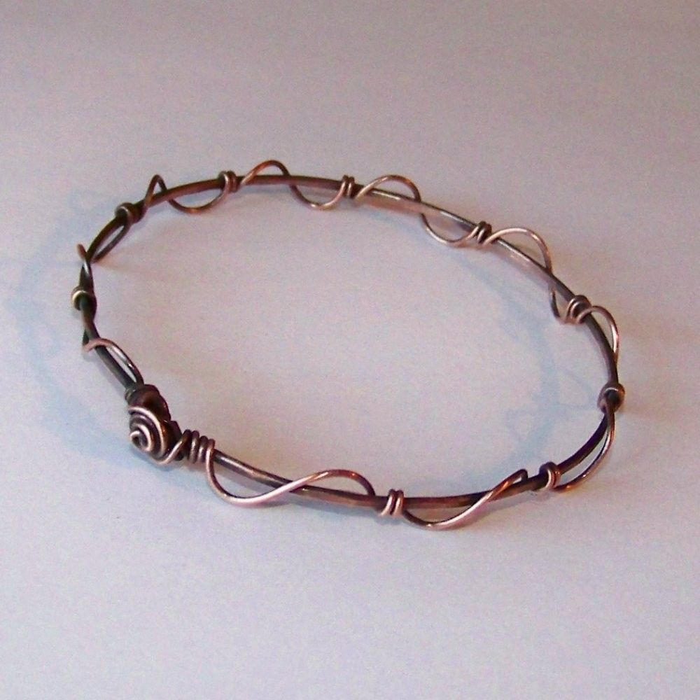 Stackable Copper Bangle - Hammered Oxidized 3 - Wire Wrapped Bangle Bracelet. $14.00, via Etsy.