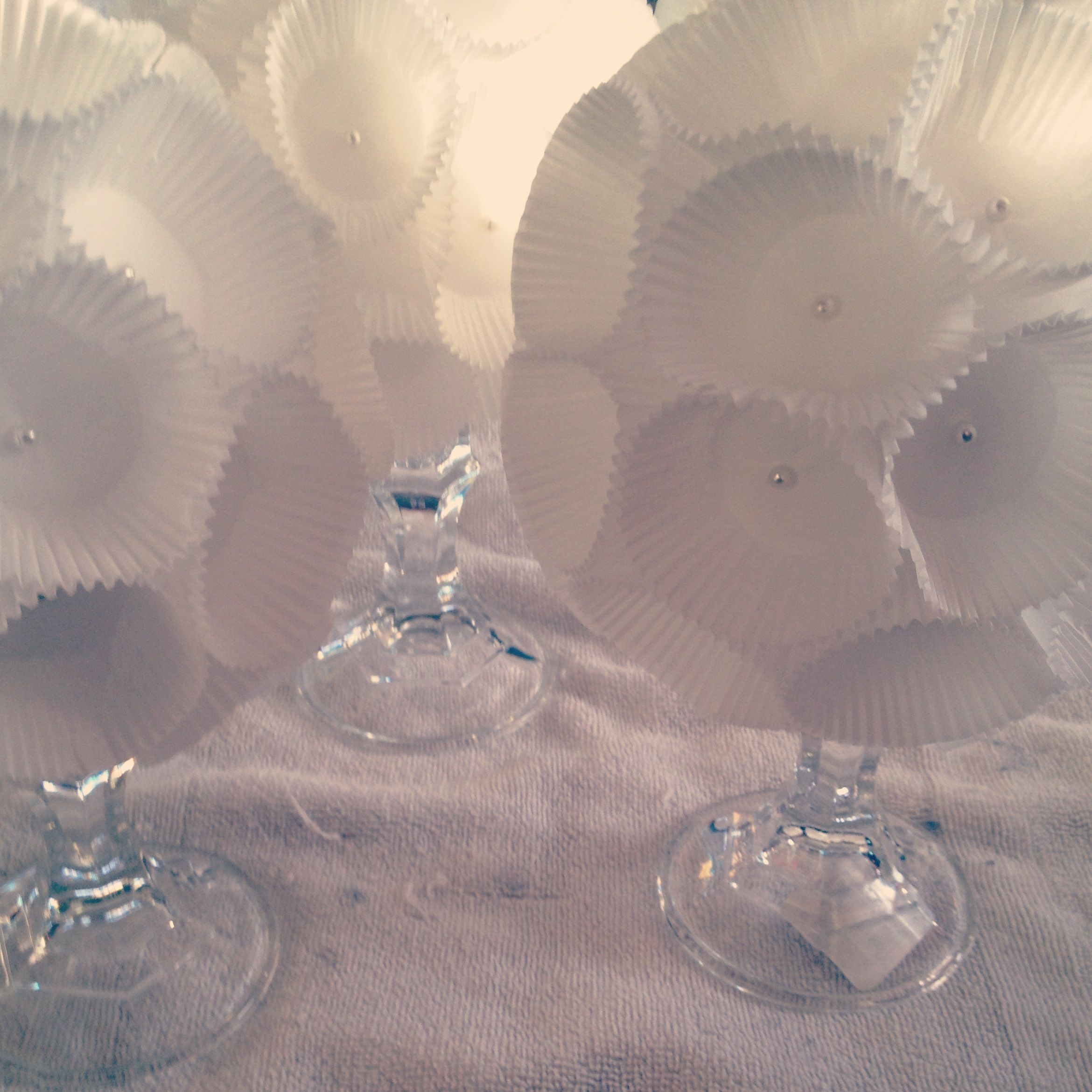 Centerpieces for Communion  Made from foam balls, pearl tipped pins, some glue, mini cupcake liners and candle holders from the dollar tree.   Easy and Cheap and look fabulous!!!