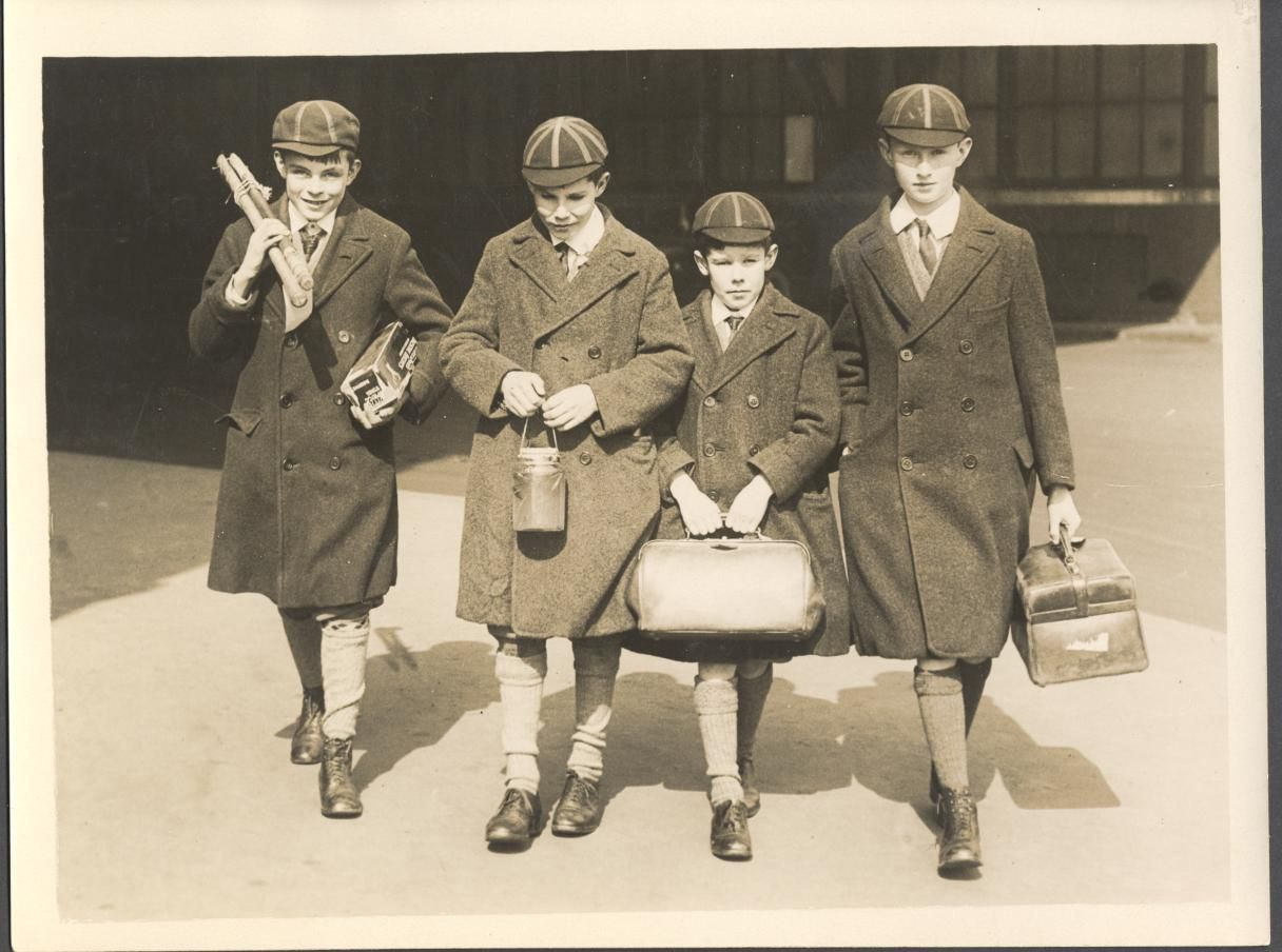 Alan Turing with school friends, Robin and John Wainwright and Hugh Highet, taken at Waterloo Station on the way to the school carriage at Charing Cross Station. [? Early 1926]. Inscribed on back with names and location