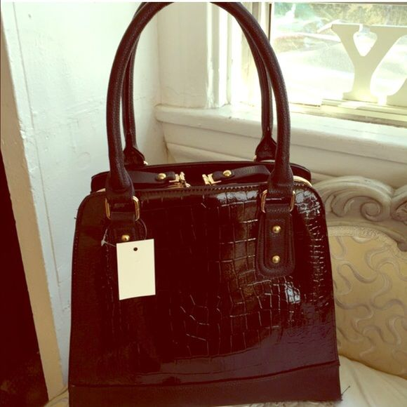 """Black large handbag Beautiful, black hand back. Very roomy. Brand new with tags. Comes with a shoulder strap. """"Zips"""" go down the side to open (see photo). Alligator skin like texture. Bags Shoulder Bags"""