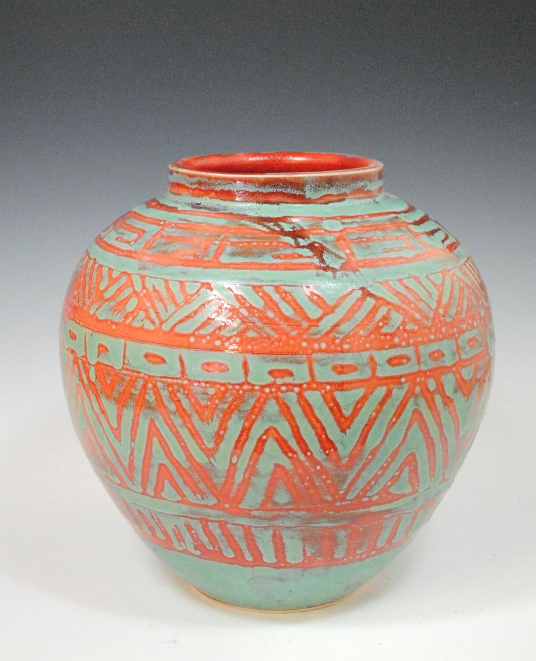 reserve for jackie medium red and green pot tribal. Black Bedroom Furniture Sets. Home Design Ideas