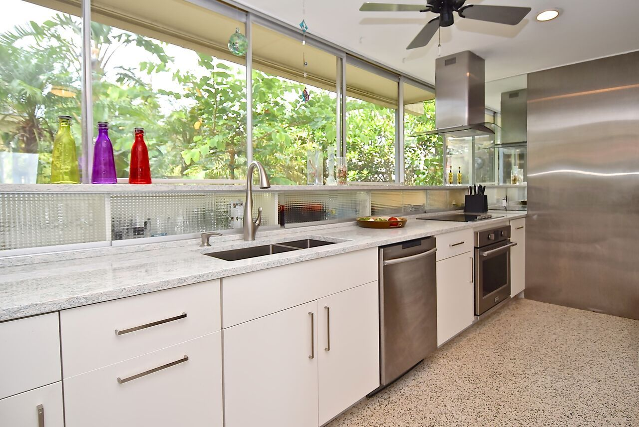 From The Giant Sliding Glass Door To The Terrazzo Floor And Modern Geometric Design This Home Is The Perfect Example Terrazzo Flooring Florida Design Kitchen