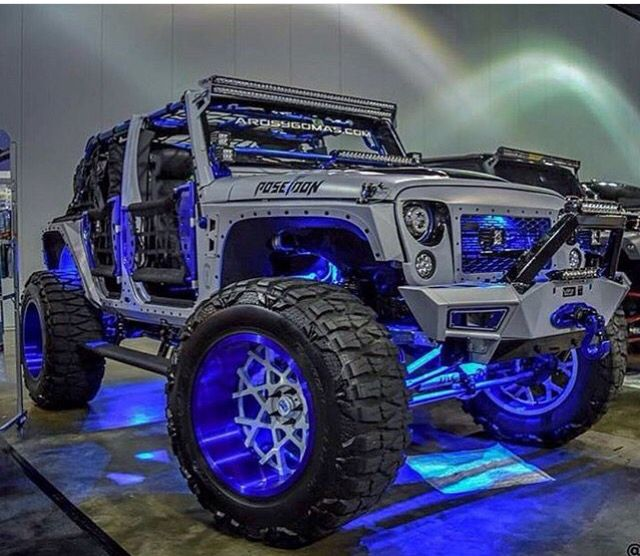 THIS SILVER JEEP JK IS DECKED OUT IN BLUE LIGHTS AND BLUE RIMS NOT TO  MENTION LIFT U0026 GREAT TIRES! (CHECK OUT THAT INDIVIDUALIZES BUMPER)!