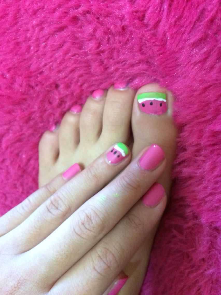 These watermelon nails are perfect for summer look delish also super cute! Here's how to do it:  Paint on 2 coats of pink polish let dry  Take a bandaid and place it on your nail to make a French tip. Paint on green polish  Take a nail polish pen(white) and paint a line under the green French tip  Use black polish to create seeds then paint over clear coat