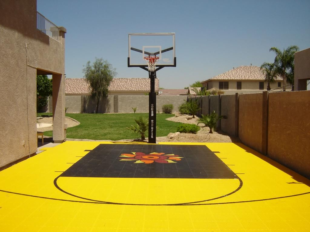 great little backyard basketball court with cool logo and colors