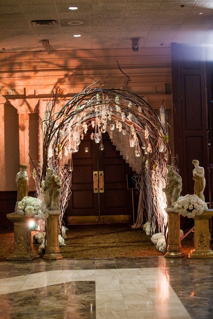 Rustic proms entrance adorned with draping flowers and a rustic