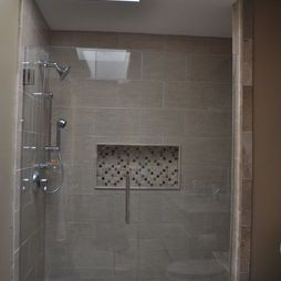 Shower With Large Rectangular Tiles And A Very Niche Ideal