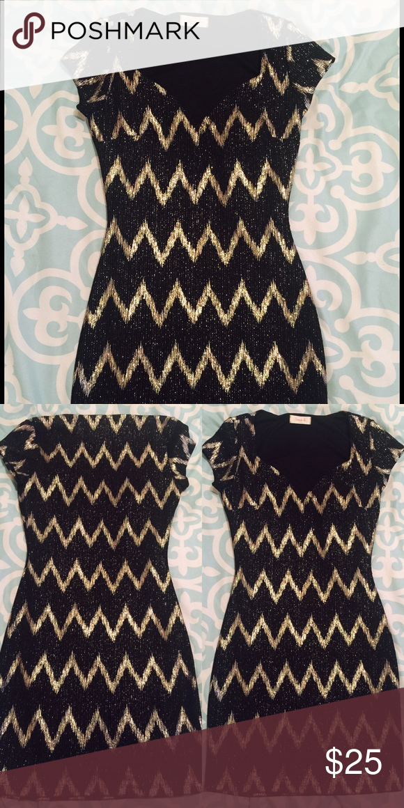 Gold and Black Party Dress This party dress was purchased from a boutique and was given to me as a gift but it is too small. It is gold and black with a very cute design pattern. It's does not have its tags but it hasn't been worn. Dresses Mini