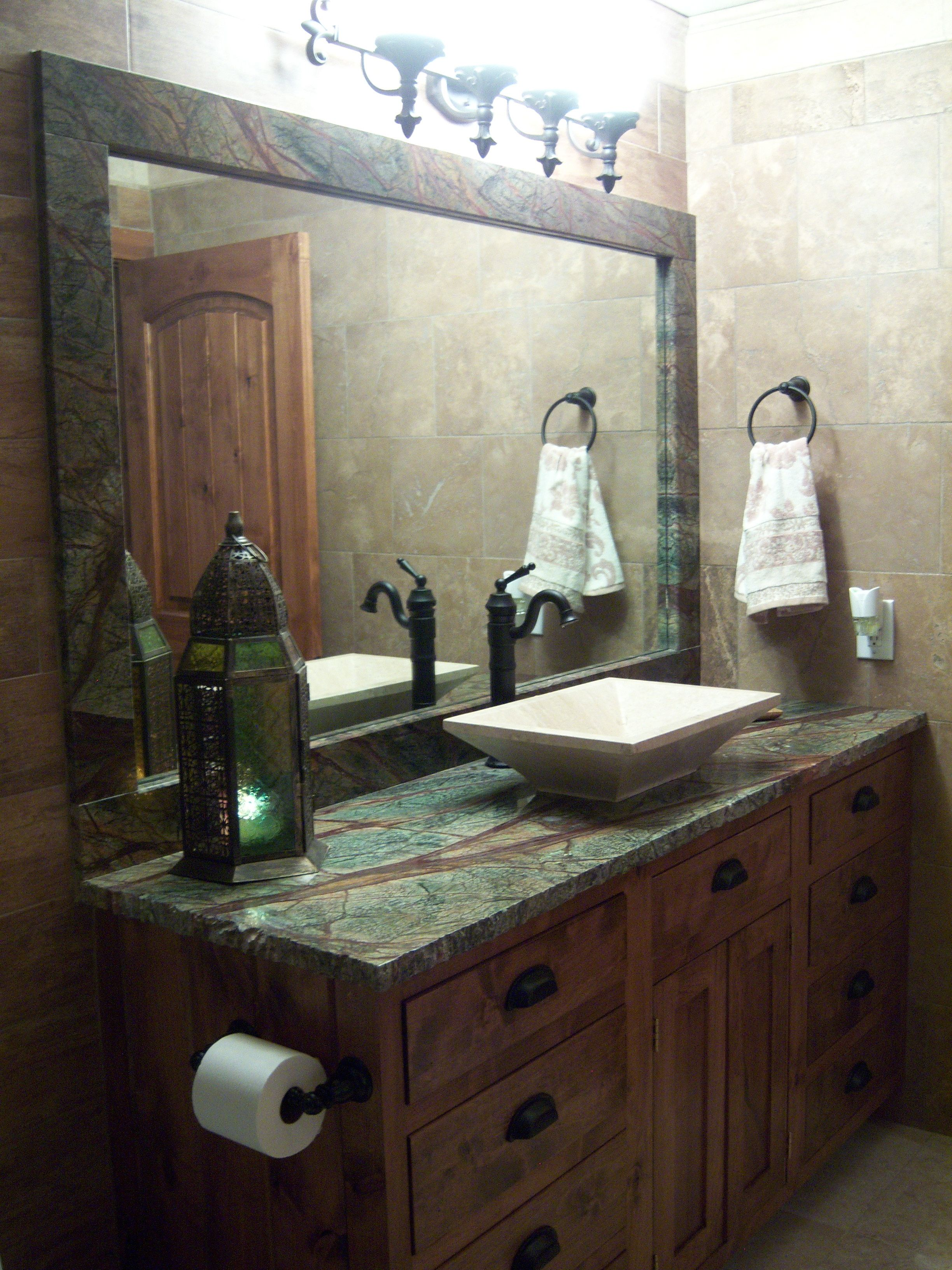 Bathroom Design With Rain Forest Green Granite Countertops And Wood  Cabinets.