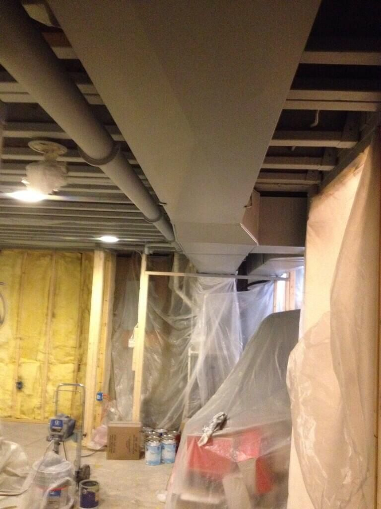 This Exposed Basement Ceiling Was Spray Painted Black Due