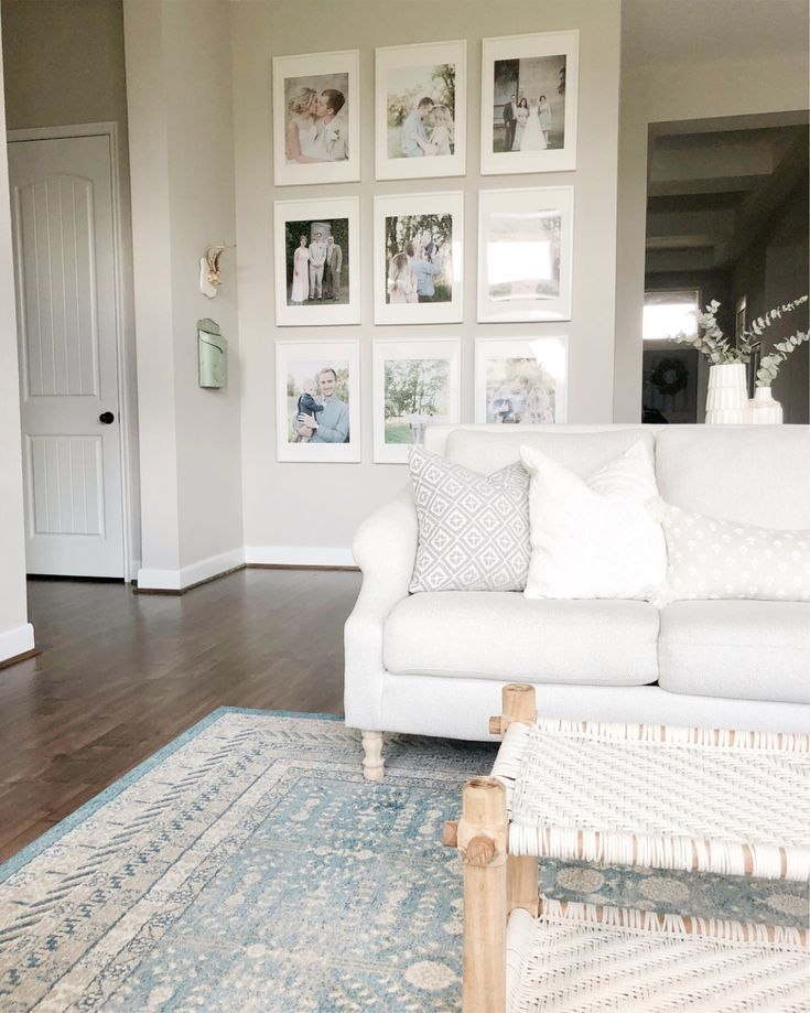 Gallery Wall In Cottage Family Room With Cottage White Sofa Neutral Living Room Farmhouse Farm House Living Room Home Living Room Living Room Decor Apartment