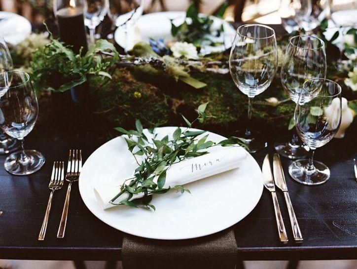 A sprig of leaves left on a dinner plate is one of many bridal accents we love. Click to see some of our favorite real-wedding photos from this past year.