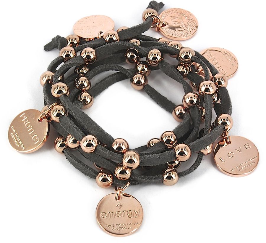 Tan Suede Modern Goddess Lariat in Rose Gold by Love From Venus  The Get Leashed Style Team loves the versatility of this suede lariat. We found this can be used as a wrap bracelet or to bling up your pony post sundown. The little rose gold charms read: karma, protect, energy, love, chakra.