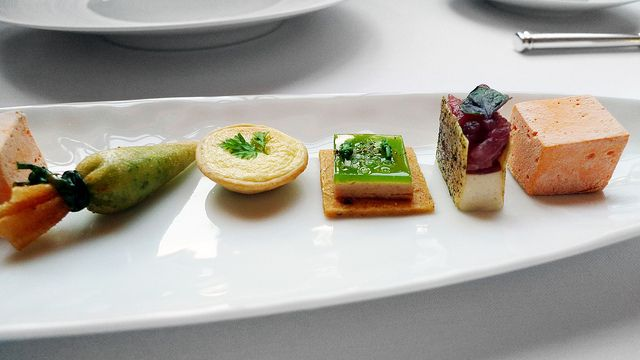 Eleven Madison Park by Annie Song, carrot marshmallow, tuna ceviche, pate with aspargus gelee, some fancy cheese tart, and a cone filled with veal sweetbreads
