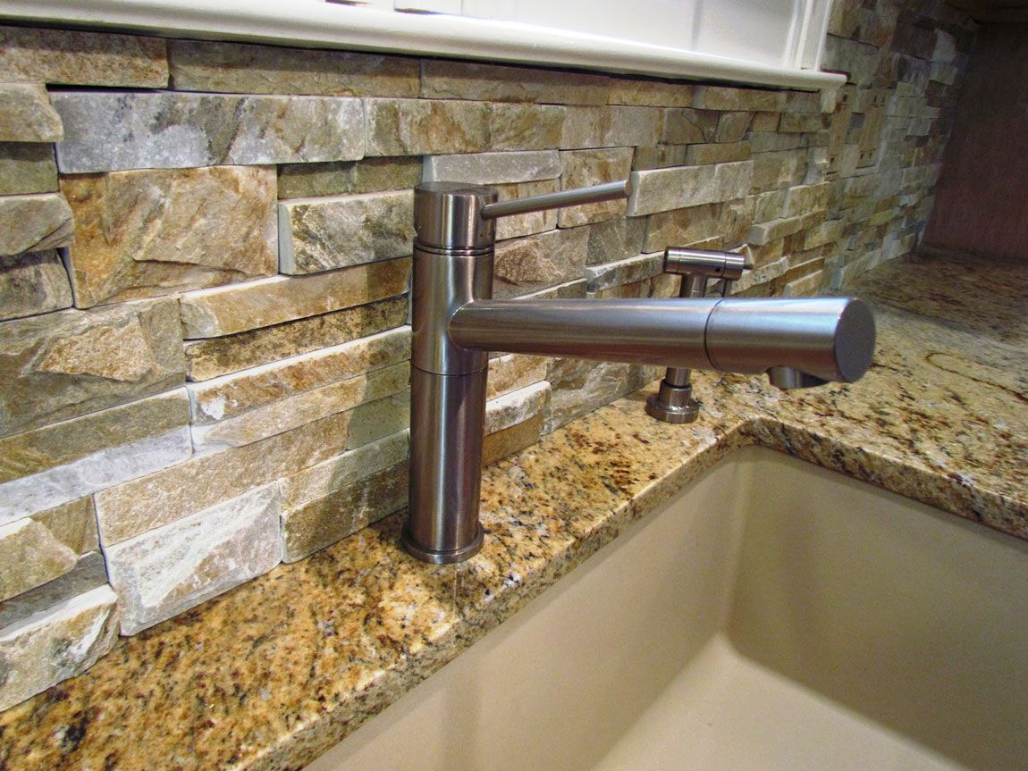 Natural stone kitchen backsplash design for kitchen interior home ledgestone or stacked stone can add great texture to a backsplash area but are harder to clean note the restricted space behind the faucet dailygadgetfo Choice Image