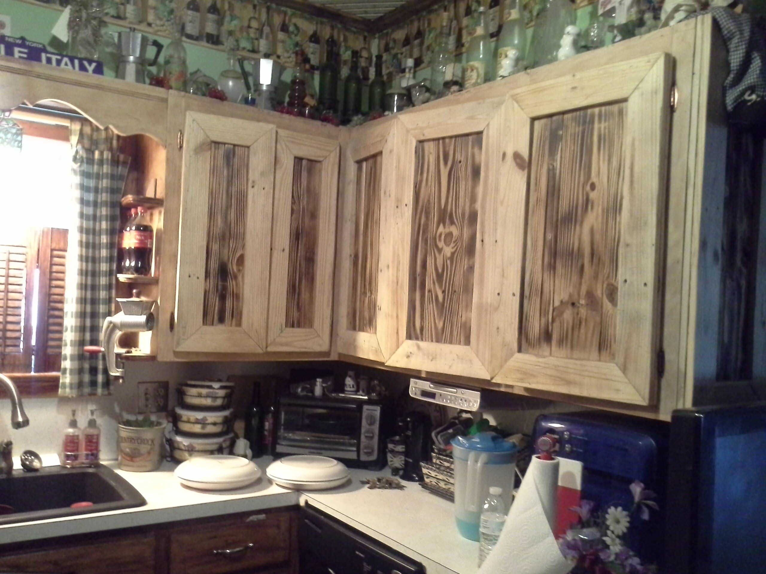 These Kitchen Items Were Made From Recycled Wooden Pallets The Lights Were Made From Small Pallet Kitchen Cabinets Pallet Kitchen Kitchen Cabinet Door Styles