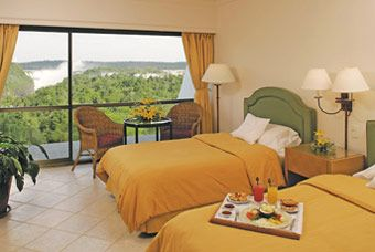 Luxury Vacation Packages to the Iguazu Falls staying at Sheraton Resot & Spa Hotel in a room with falls view. Proffesional tour guides to explore the National Parks.  http://www.01argentina.com/sitio/eng/tours/iguazu_falls_sheraton.html