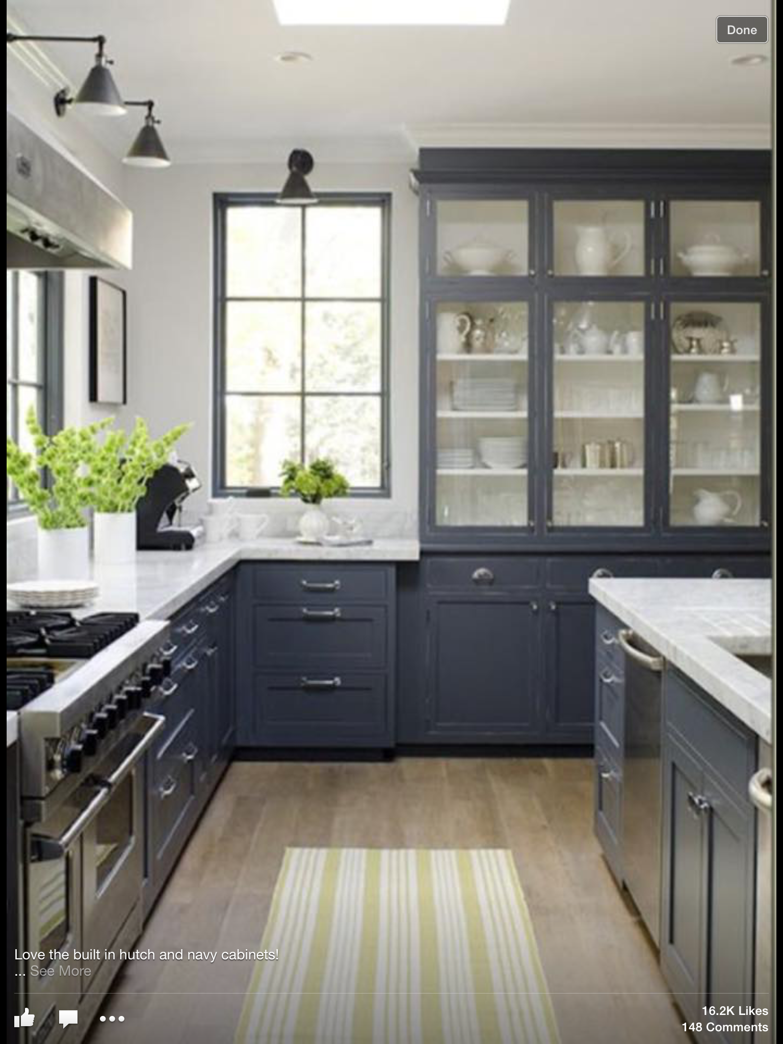 dark grey kitchen cabinets white walls black window