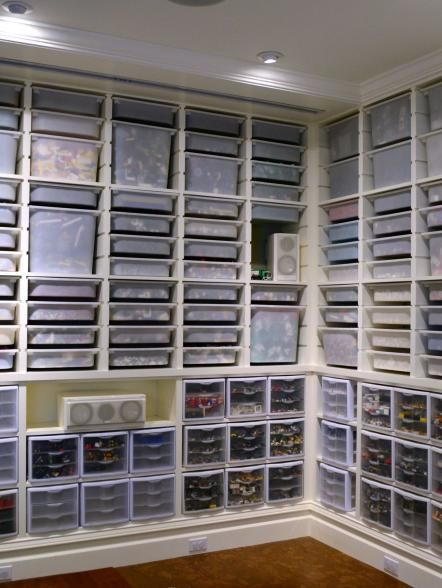 This spacious basement features a wall-to-wall shelving unit that has been fitted with convenient pullout drawers for stowing away small Lego pieces. & This+spacious+basement+features+a+wall-to-wall+shelving+unit+that+ ...
