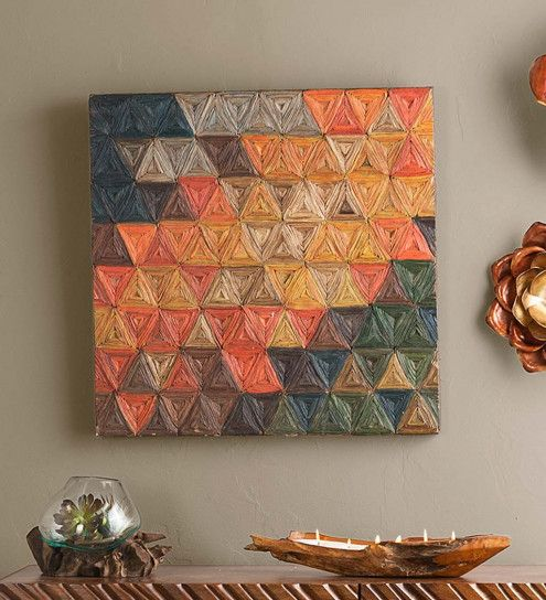 Banana Bark Triangle Wall Art is part of Modern Home Accents Wall Art - This multicolor array of triangles is created by Indonesia artisans using genuine banana bark  This beautiful piece adds both color and texture to your walls, and perfectly structural geometric shapes with organic natural lines  Each piece is a oneofakind, as they are all handmade from banana tree bark  The gradient of hot and cold colors it features allows it to fit into a variety of decorative styles and palettes  This colorful, handmade, natural work of art adds texture and naturalstyle to the home Created in Indonesia Artisanmade with natural materials 31 5 Sq  x 2 D