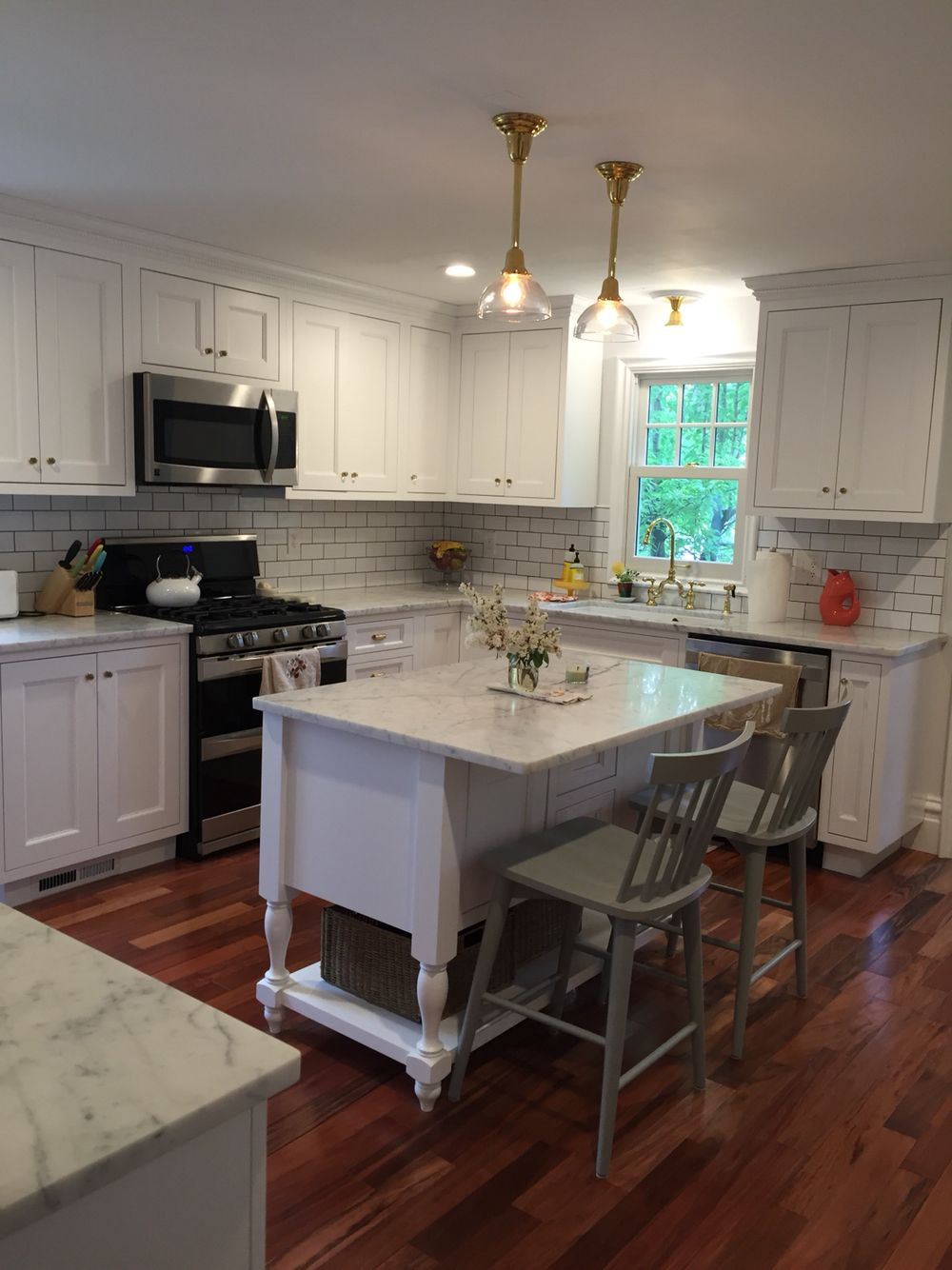 White Candelight Chesapeake Inset Cabinets, Honed Statuarietto Marble  Counters, Brass Hardware, Red Tiger
