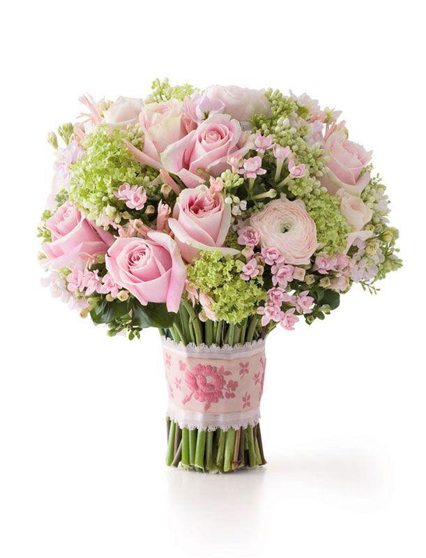 Ribbon-tied bouquet of bouvardia, lilacs, nerine, ranunculus and 'Rosita Vendela' roses