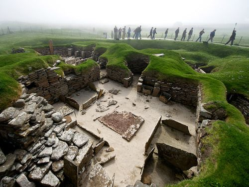 Skara Brae, Scotland  Photograph by KEENPRESS, National Geographic  Visitors peer into the past in the Orkney Islands, where in 1850 a strong storm uncovered the remains of the Skara Brae settlement. Later excavations revealed a complex of stone houses linked by passageways that dates to between 3200 and 2500 B.C. It's considered the best preserved Neolithic village ever found in northern Europe and is a World Heritage site.