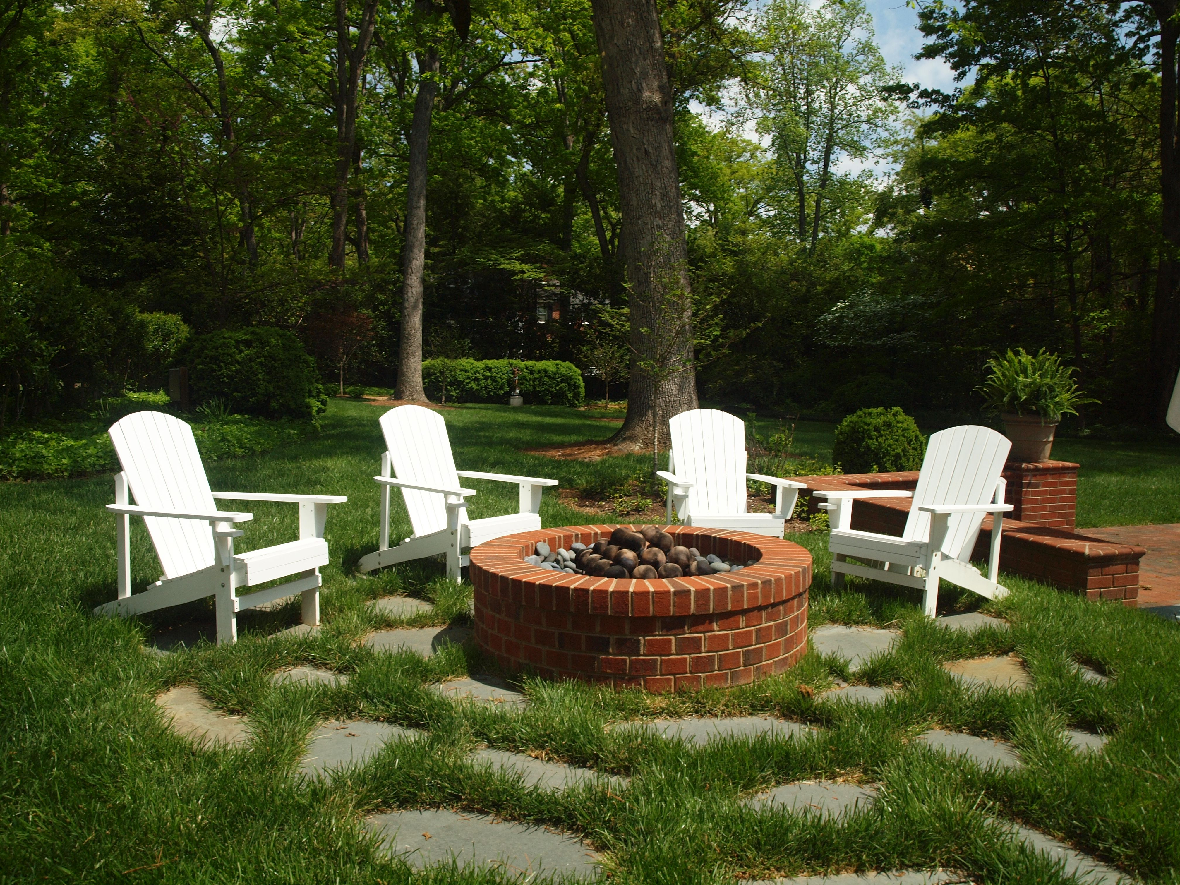 adirondack chairs provide comfortable seating around the fire pit